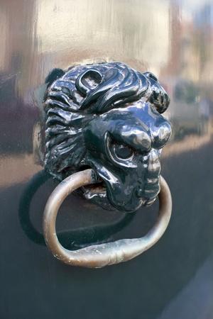 doorknocker: closeup of decorative traditional Dutch lion head door knob Stock Photo