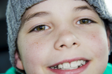 closeup of cute young teen boy in hat smiling photo
