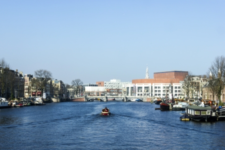 cruiseboat: Amsterdam city in the Netherlans, boat in the river Amstel
