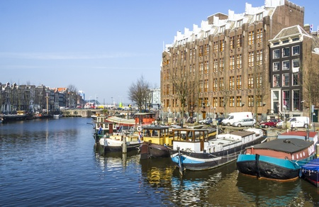 Classical Amsterdam view on a canal, the Netherlands photo