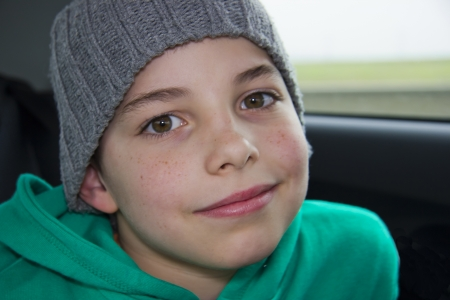freckles: closeup of cute young teen boy in  gray hat Stock Photo
