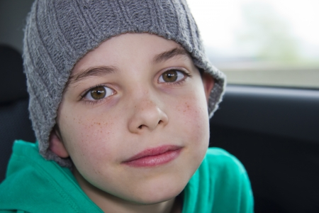 scallywag: closeup of cute young teen boy in  gray hat Stock Photo