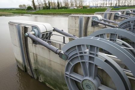 dikes: A dam across a river near Mont Saint-Michel in France Stock Photo