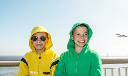 romantics: Two smiling teenage boys on deck of ferry - romantics
