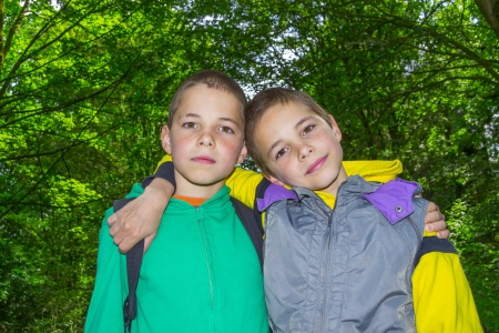 Portrait of two hugging boys, tweens photo