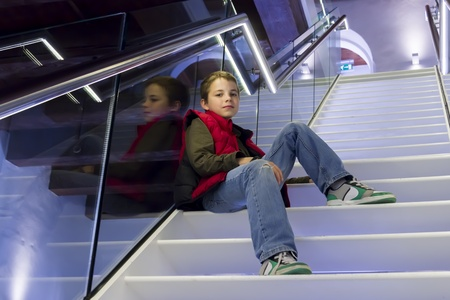 portrait of teenage  boy on the stairs photo