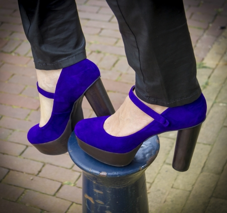 a pair of purple shoes womens heels on the column photo