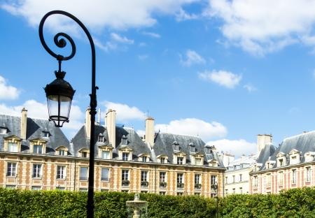 victor: View on Place des Vosges, Paris, France
