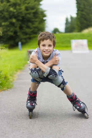 rollerskater: Portrait of smiling rollerskater in protection kit Stock Photo