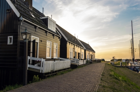 volendam: Holland, Volendam village (Amsterdam), typical old dutch houses into the sunset