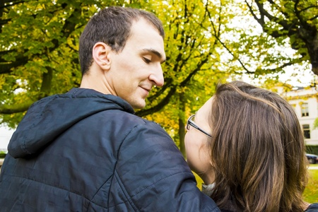 Back View Of Romantic Couple In Autumn Landscape photo