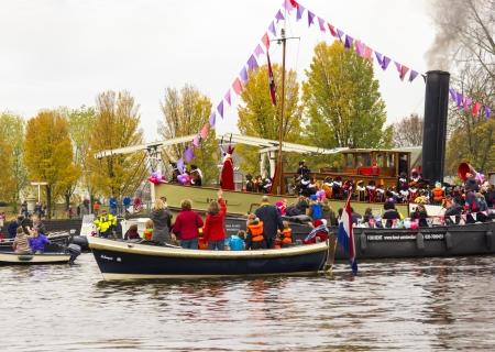 AMSTERDAM, NETHERLANDS - NOVEMBER 18  Santa Claus arrives in Holland by boat on November 18, 2012 in Amsterdam, Netherlands  Stock Photo - 16372355