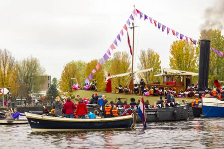 AMSTERDAM, NETHERLANDS - NOVEMBER 18  Santa Claus arrives in Holland by boat on November 18, 2012 in Amsterdam, Netherlands  Stock Photo - 16372353