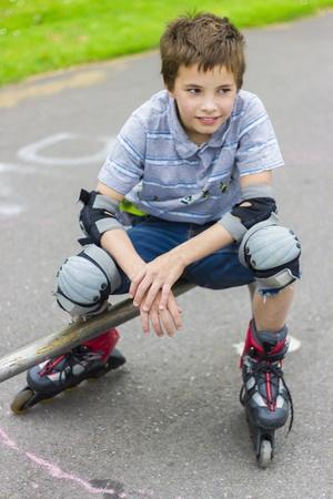 rollerskater: Portrait of smiling rollerskater in protection kit Stock Photo