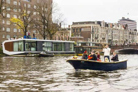 AMSTERDAM, THE NETHERLANDS - NOVEMBER, 18, 2012 - Trumpeter playing on a boat carrying people greet Sinterklaas. Santa Claus(Sinterklaas) traditionally arriving in Holland by steamboat from Spain in November. Stock Photo - 16679740