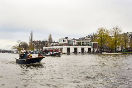 AMSTERDAM, THE NETHERLANDS - NOVEMBER, 18, 2012 - Trumpeter playing on a boat carrying people greet Sinterklaas. Santa Claus(Sinterklaas) traditionally arriving in Holland by steamboat from Spain in November. Stock Photo - 16679738