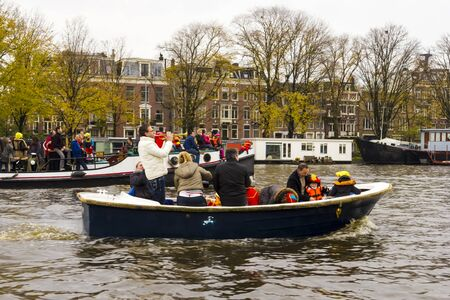 AMSTERDAM, THE NETHERLANDS - NOVEMBER, 18, 2012 - Trumpeter playing on a boat carrying people greet Sinterklaas. Santa Claus(Sinterklaas) traditionally arriving in Holland by steamboat from Spain in November. Stock Photo - 16679741