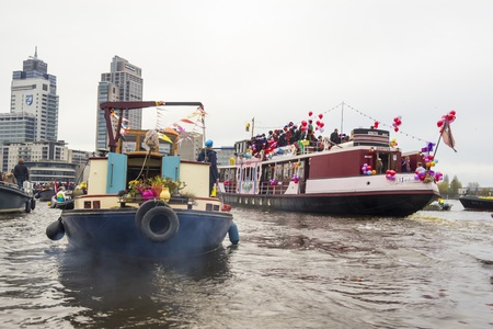 amstel river: AMSTERDAM, THE NETHERLANDS - NOVEMBER, 18, 2012 - Santa Claus(Sinterklaas) traditionally arriving in Holland by steamboat from Spain in November.