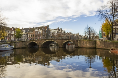 View on a canal bridge in Amsterdam in late autumn photo