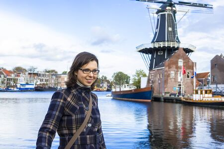dutch girl: Girl on waterfront in Dutch town of Haarlem, the Netherlands Stock Photo