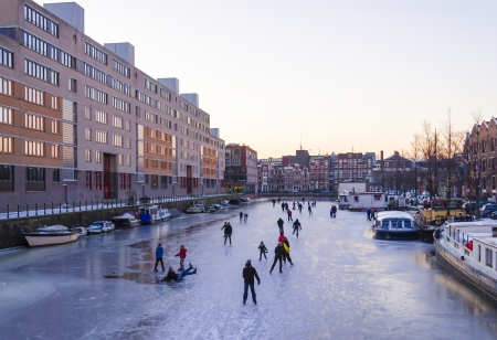 typically dutch: Ice skating on the canals in Amsterdam