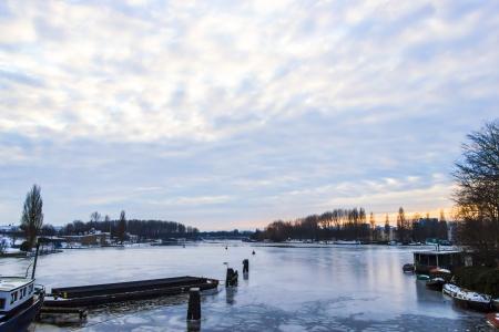 amstel river: Frozen Amstel river in wintertime in Amsterdam, the Netherlands