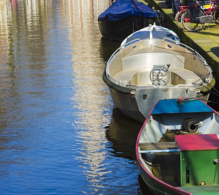Modern boats on the canal of Amsterdam Stock Photo - 17211898
