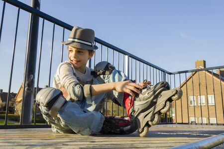 10 15 years: smiling teenage boy in roller-blading protection kit Stock Photo