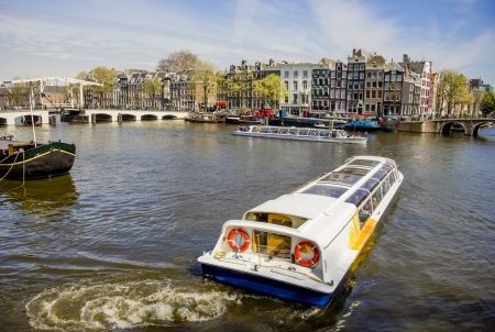 cruiseboat: View on Amsterdam and Amstel rive with cruise boats , the Netherlands