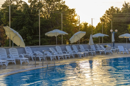 the setting sun: Swimming pool in the rays of the setting sun Stock Photo