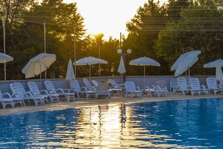 setting sun: Swimming pool in the rays of the setting sun Stock Photo