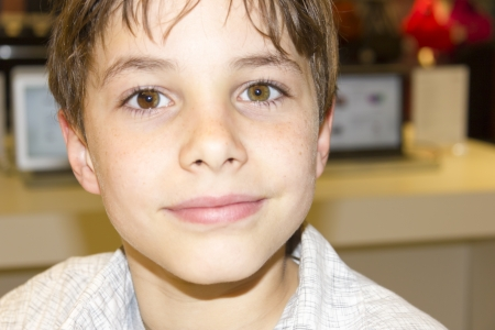 light brown eyes: portrait of a cute young boy closeup