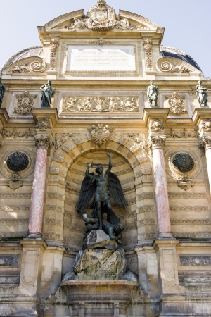 Fountain Saint-Michel at Place Saint-Michel in Paris, France  It was constructed in 1858-1860 during French Second Empire by architect Gabriel Davioud  Archangel Michael and devil by Francisque Duret  photo