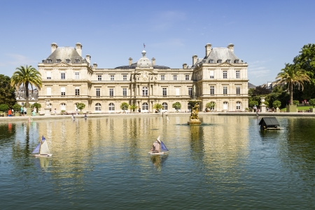 Traditional small wooden sailing boat in the pond of park Jardin du Luxembourg, Paris, France photo
