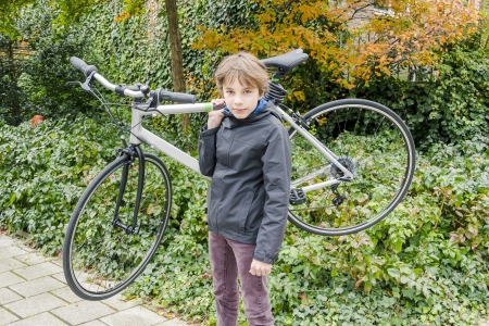 young boy carrying his bike Stock Photo - 23574603