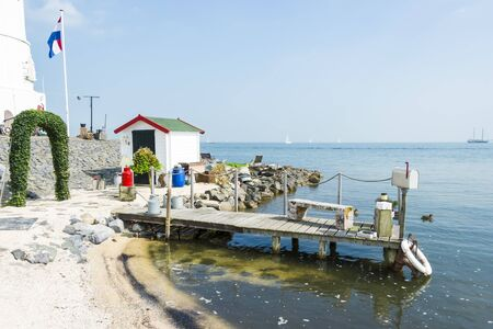 marken: Picturesque pier near the lighthouse, Marken, Netherlands Stock Photo