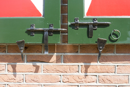 Close-up shot of a latches on a wooden Dutch doors photo