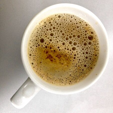 frothy: Cup of frothy coffee