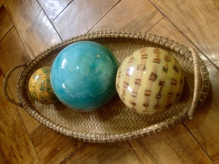 vernacular: Resin balls centerpiece in a woven basket