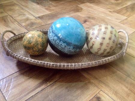 woven: Resin balls centerpiece in a woven basket