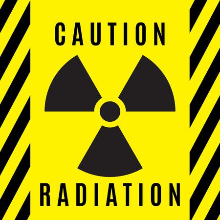 El signo de peligro radiactivo ejecutado en color negro y situado sobre un fondo amarillo.