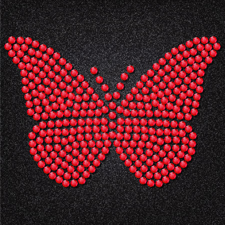Butterfly built of red gems on a background of black and gray fabric.