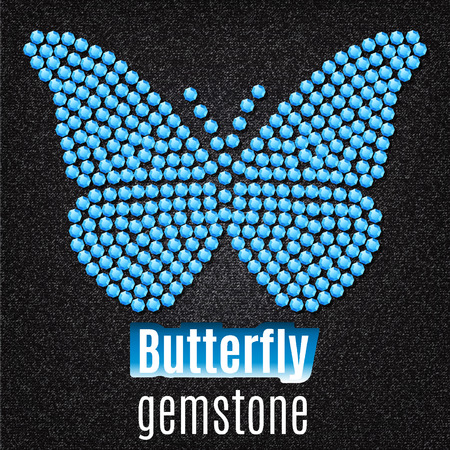 Butterfly built of blue gemstone sapphire, against the background of black and gray fabric.