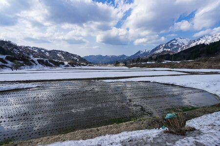 Rice paddy left with snow remaining