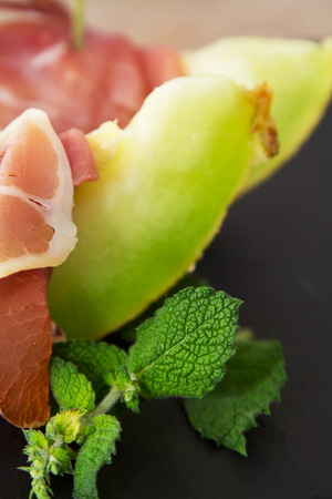 Appetizers: melon with ham Stock Photo