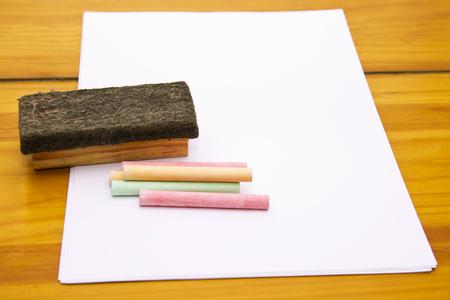 chalk eraser: paper sheet on wood with eraser and chalk