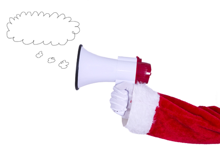 announcing: Santa Claus hand with megaphone announcing Christmas Stock Photo