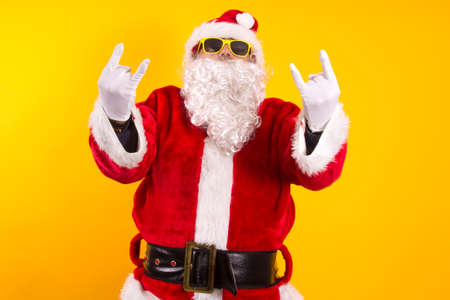 Santa Claus making negative gesture against Christmas with index finger
