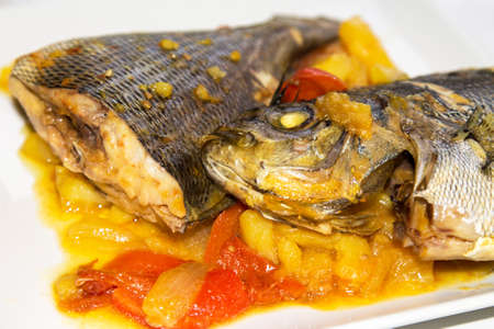 Baked fish with potatoes and red peppers