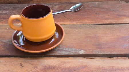 coffee table: coffee cup on wood table